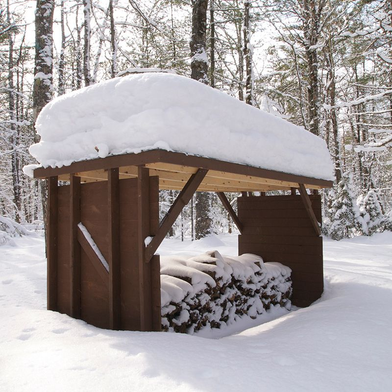Feet of snow piled on top of wood shelter