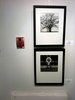 Two black and white photos, framed, on the wall